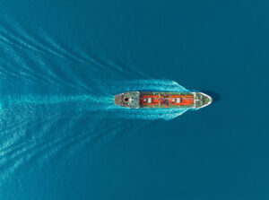 Boat travelling through blue sea