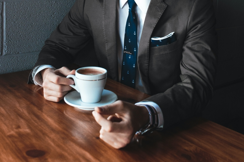 Suited male with coffee